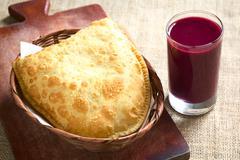 Pastel, a Bolivian Snack with Api, a Purple Corn Beverage - stock photo
