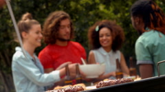In high quality format man using meat thermometer while barbecuing Stock Footage