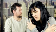 Woman angry with boyfriend at home feeling sad - stock footage