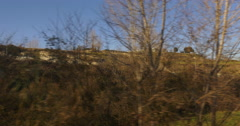 Sunny day train ride window view across mountain winter hills 4k spain Stock Footage