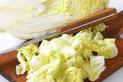 Chopped Chinese cabbage on cutting board Stock Photos