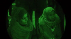 PVS 14 night vision - Candlelight vigil for Palestine - stock footage