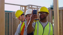 Construction workers taking selfie with cell phone - stock footage