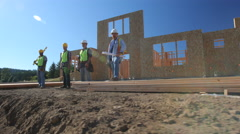 Group of construction workers standing in front of job site - stock footage