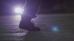 Slow motion shot of man skipping at night with a jump rope - stock footage
