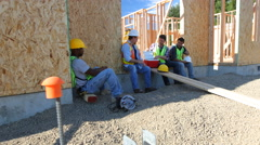 Group of construction workers taking a break Stock Footage
