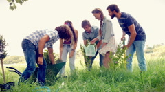 In high quality format happy friends gardening for the community - stock footage