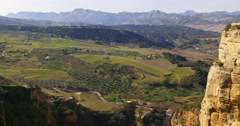 Stock Video Footage of sunny day ronda town mountain view on  mountains fields 4k spain