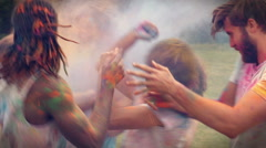 In high quality format happy friends throwing powder paint - stock footage