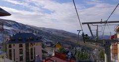Sierra nevada day time riding ski lift panoramic view 4k spain Stock Footage