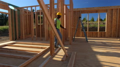 Construction workers working on job site - stock footage