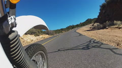 Low Angle Motorcycle On Curving Mountain Road- Kingman AZ Stock Footage