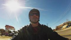 Man Riding Motorcycle In Kingman Arizona Past Motels Stock Footage