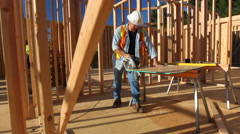 Construciton worker cutting board Stock Footage