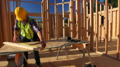 Construction worker measuring board Stock Footage