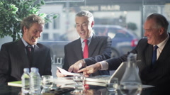 4K Friendly cheerful businessmen shake hands at end of a business meeting - stock footage