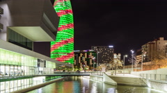 Night light museum of design torre agbar view 4k time lapse spain barcelona Stock Footage