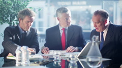 4K Friendly cheerful businessmen laughing together in business meeting - stock footage