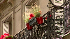 Parisian Terrace in the rain with flower box and  Stock Footage