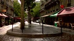 Classic Parisian Street with Cobble Stones and Cafes Stock Footage