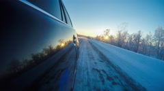 Car driving at sunset in Arctic conditions Stock Footage