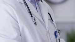 Closeup of doctor using cell phone Stock Footage