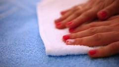 Close-up of woman putting fresh clean towel on bed and then smoothing it with Stock Footage
