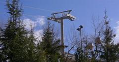 Sunny day ski resort riding lift 4k sierra nevada spain Stock Footage