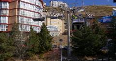 sierra nevada mountain ski resort riding lift going up on hill 4k spain - stock footage
