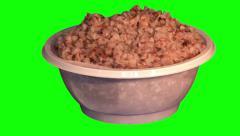 Kasha (boiled buckwheat) in throwaway plate Stock Footage