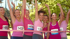 In high quality format smiling women running for breast cancer awareness Stock Footage