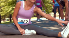 In high quality format fit woman warming up before race - stock footage