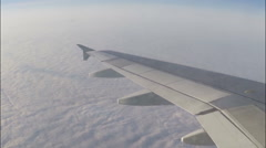 Slyder slider cam Airplane Window View Of Clouds From Passenger Seat Stock Footage