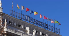 Sun light madrid hotel roof top flags 4k spain Stock Footage