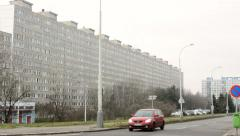 Old vintage high-rise block of flats (communism) and road - cloudy Stock Footage
