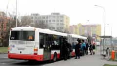 Housing development (high-rise block of flats) with the road - bus stop Stock Footage