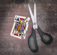 Concept of addiction, card with scissors Stock Photos