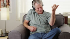 Happy Senior man air guitar Stock Footage