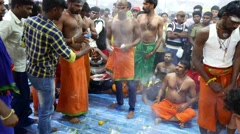 4K UHD video of devotees gathering for prayers on Thaipusam day Stock Footage