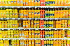 Orange Soda Juice Bottles On Supermarket Stock Photos