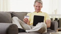 Senior man shopping online on tablet - stock footage