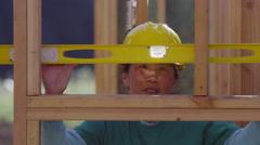 Volunteer checking level, closeup - stock footage