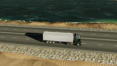 Truck driving along the coastal road Stock Footage