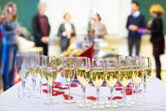 Banquet event. Waiter pouring champagne into glass. Kuvituskuvat