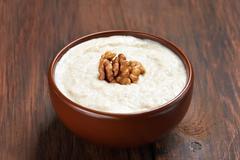 Oatmeal porridge with walnuts Stock Photos