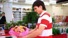 Young man buying  bouquet romantic flower market florist. HD. 1920x1080 Stock Footage