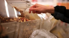 Men hands buys hazelnut in supermarket. Close up, hd, 1920x1080 Stock Footage