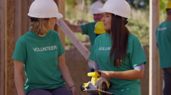 Volunteers working together on construction project - stock footage