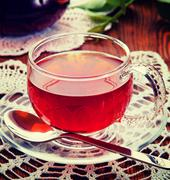 Tea in a glass cup. Vintage retro hipster style version Stock Photos