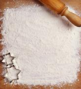 Rolling pin, flour and forms for cookies on the boards Stock Photos